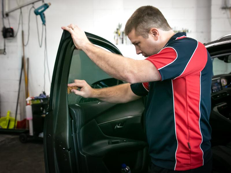 North Lakes professional window tinter installing car window tint